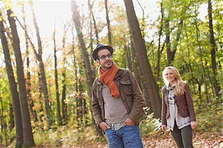 Smiling couple standing in forest Stock Photo - Premium Royalty-Free, Code: 649-06489793