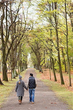 Couple walking together in park Stock Photo - Premium Royalty-Free, Code: 649-06489822