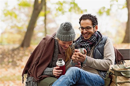 Couple drinking coffee on park bench Stock Photo - Premium Royalty-Free, Code: 649-06489836