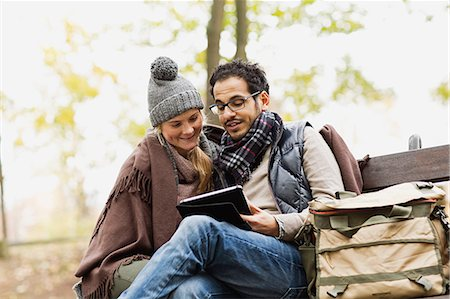 people sitting on bench - Couple using tablet computer in park Stock Photo - Premium Royalty-Free, Code: 649-06489837