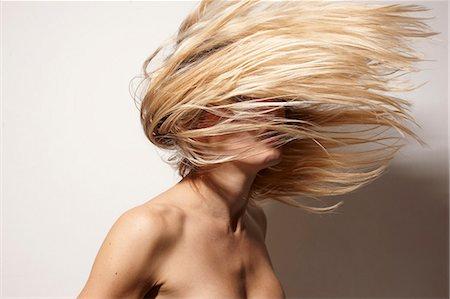female nud - Semi nude woman tossing her hair Stock Photo - Premium Royalty-Free, Code: 649-06489885