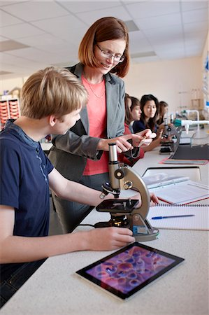 Teacher with student in science class Stock Photo - Premium Royalty-Free, Code: 649-06489952