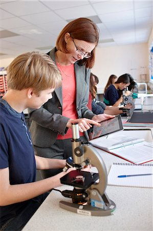 Teacher with student in science class Stock Photo - Premium Royalty-Free, Code: 649-06489953