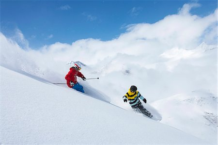 sports and snowboarding - Skier and snowboarder on snowy slope Stock Photo - Premium Royalty-Free, Code: 649-06490014