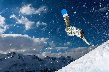 sports and snowboarding - Snowboarder jumping on snowy slope Stock Photo - Premium Royalty-Free, Code: 649-06490025