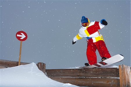 sports and snowboarding - Snowboarder sliding on wooden fence Stock Photo - Premium Royalty-Free, Code: 649-06490026