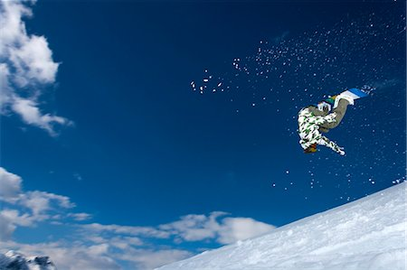 sports and snowboarding - Snowboarder jumping on snowy slope Stock Photo - Premium Royalty-Free, Code: 649-06490023