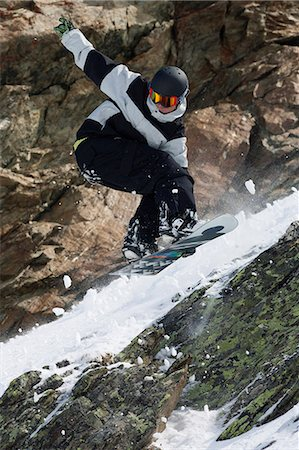 sports and snowboarding - Snowboarder jumping on rocky slope Stock Photo - Premium Royalty-Free, Code: 649-06490038