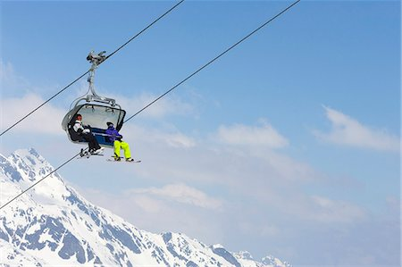 sports and snowboarding - Snowboarders riding chair lift Stock Photo - Premium Royalty-Free, Code: 649-06490039