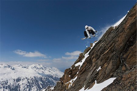 sports and snowboarding - Snowboarder jumping on rocky slope Stock Photo - Premium Royalty-Free, Code: 649-06490040