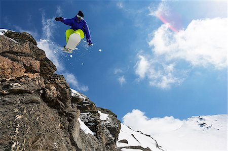 sports and snowboarding - Snowboarder jumping on rocky slope Stock Photo - Premium Royalty-Free, Code: 649-06490041