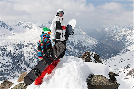 sports and snowboarding - Snowboarders on rocky mountaintop Stock Photo - Premium Royalty-Free, Code: 649-06490042