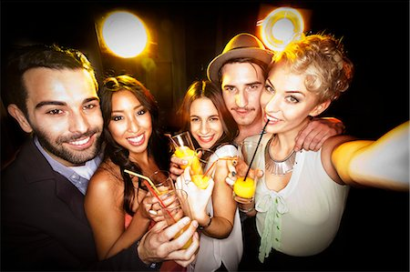 party - Smiling friends taking picture together Stock Photo - Premium Royalty-Free, Code: 649-06490069