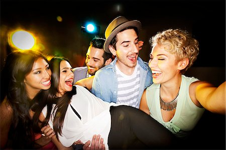 party - Smiling friends taking picture together Stock Photo - Premium Royalty-Free, Code: 649-06490074