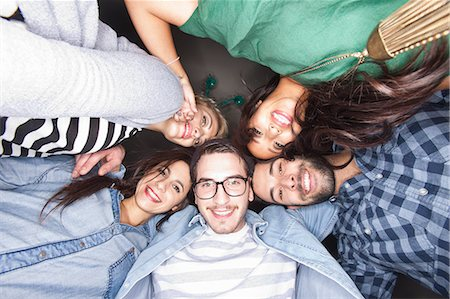 five - Friends smiling together in circle Stock Photo - Premium Royalty-Free, Code: 649-06490086