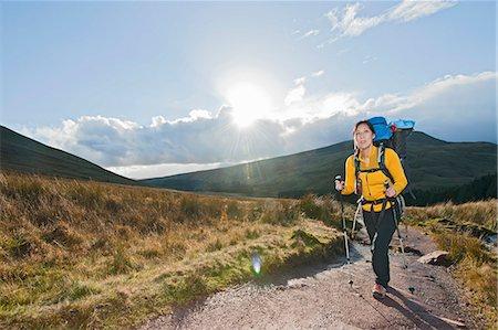 Hiker walking up gravel path Stock Photo - Premium Royalty-Free, Code: 649-06490096