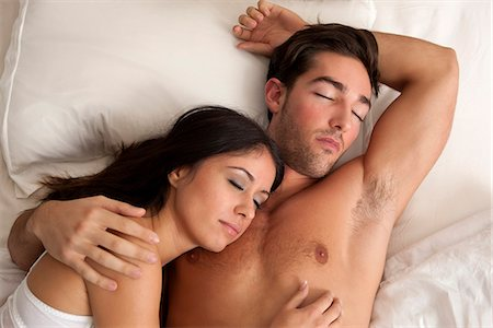 Couple sleeping in bed Stock Photo - Premium Royalty-Free, Code: 649-06532549