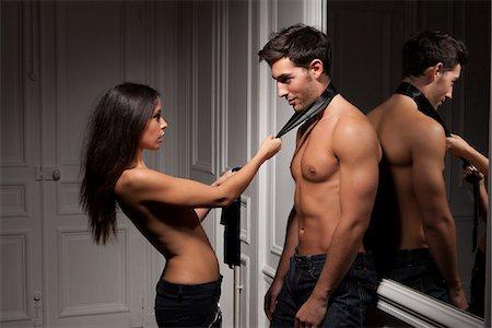 pulling - Woman grabbing boyfriend by tie Stock Photo - Premium Royalty-Free, Code: 649-06532543