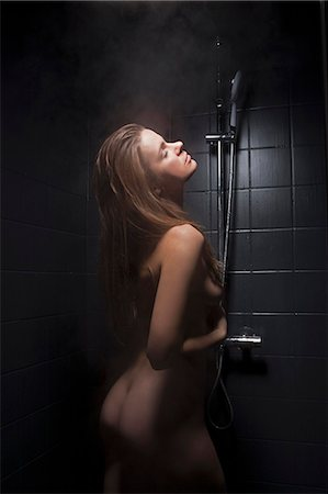 Woman washing herself in shower Stock Photo - Premium Royalty-Free, Code: 649-06532560