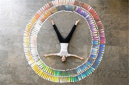 designer (female) - Businessman laying in paint swatches Stock Photo - Premium Royalty-Free, Code: 649-06532589