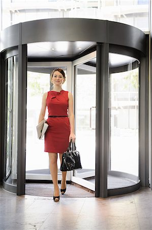 pretty - Businesswoman walking in lobby Stock Photo - Premium Royalty-Free, Code: 649-06532596