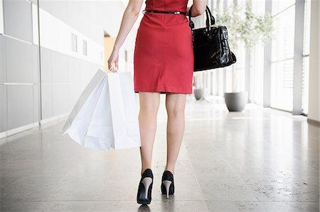 Businesswoman walking in lobby Stock Photo - Premium Royalty-Free, Code: 649-06532597