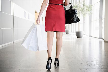 people on mall - Businesswoman walking in lobby Stock Photo - Premium Royalty-Free, Code: 649-06532597