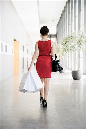Businesswoman walking in lobby Stock Photo - Premium Royalty-Free, Code: 649-06532598
