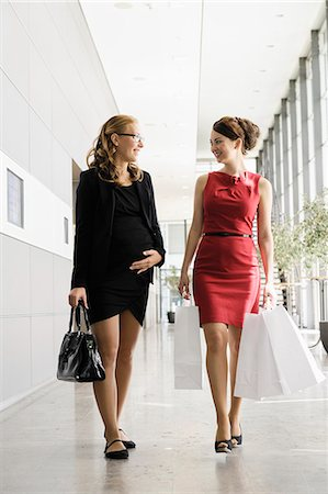 shopping mall - Businesswomen talking in lobby Stock Photo - Premium Royalty-Free, Code: 649-06532599