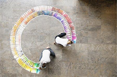 partnership - Business people examining paint swatches Stock Photo - Premium Royalty-Free, Code: 649-06532592