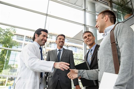 partnership - Doctor and businessman shaking hands Stock Photo - Premium Royalty-Free, Code: 649-06532618