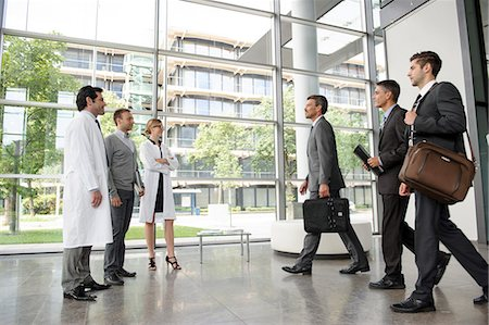 people hospital - Doctors and businessmen meeting Stock Photo - Premium Royalty-Free, Code: 649-06532619