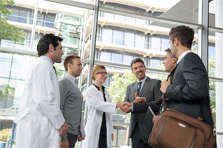people hospital - Doctors and businessmen meeting Stock Photo - Premium Royalty-Free, Code: 649-06532621