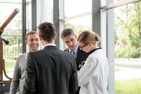 people hospital - Doctor and businessmen talking Stock Photo - Premium Royalty-Free, Code: 649-06532623