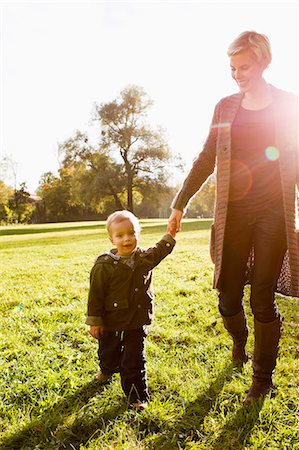 Mother and son walking in park Stock Photo - Premium Royalty-Free, Code: 649-06532678