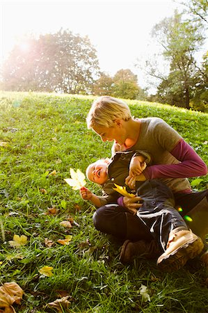 Mother and son playing in park Stock Photo - Premium Royalty-Free, Code: 649-06532687