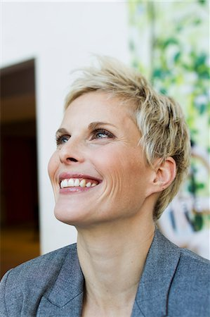 short hair - Close up of womans smiling face Stock Photo - Premium Royalty-Free, Code: 649-06532713