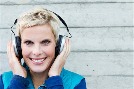 Smiling woman listening to headphones Stock Photo - Premium Royalty-Free, Code: 649-06532725