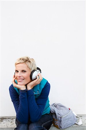 Smiling woman listening to headphones Stock Photo - Premium Royalty-Free, Code: 649-06532727