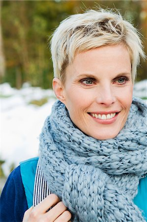 Woman wearing knitted scarf outdoors Stock Photo - Premium Royalty-Free, Code: 649-06532722