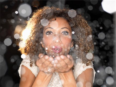 sparkling - Woman blowing confetti from hands Stock Photo - Premium Royalty-Free, Code: 649-06532757