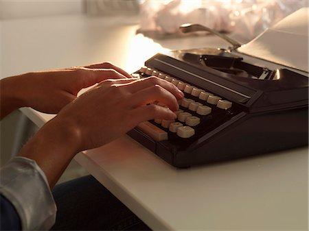 Close up of woman using typewriter Stock Photo - Premium Royalty-Free, Code: 649-06532751
