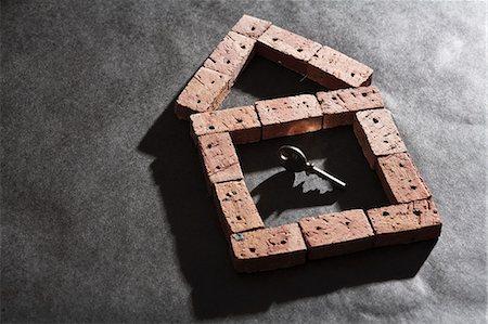 Bricks in house shape with key Stock Photo - Premium Royalty-Free, Code: 649-06532922