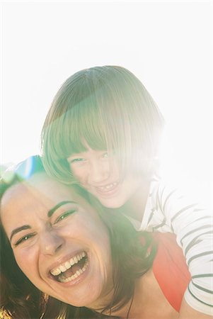 Mother and daughter hugging outdoors Stock Photo - Premium Royalty-Free, Code: 649-06533026