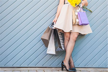 Woman holding shopping bags outdoors Stock Photo - Premium Royalty-Free, Code: 649-06533043