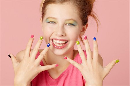preteen beauty - Smiling girl wearing colorful makeup Stock Photo - Premium Royalty-Free, Code: 649-06533094