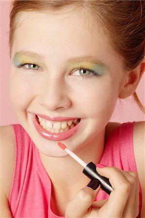 preteen beauty - Smiling girl wearing colorful makeup Stock Photo - Premium Royalty-Free, Code: 649-06533096