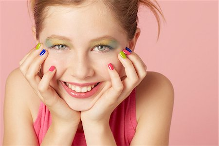 preteen beauty - Smiling girl wearing colorful makeup Stock Photo - Premium Royalty-Free, Code: 649-06533090