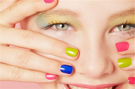 preteen beauty - Smiling girl wearing colorful makeup Stock Photo - Premium Royalty-Free, Code: 649-06533093