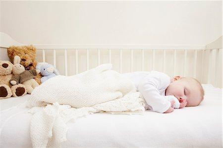 sucking - Baby girl sleeping in crib Stock Photo - Premium Royalty-Free, Code: 649-06533135